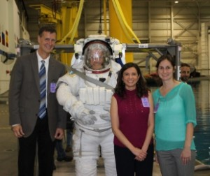 Emery, Rios and Sutherland at the Neutral Buoyancy Lab with an astronaut exiting the training pool