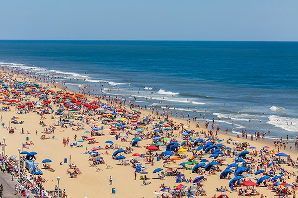 A photo of a crowded beach. Photo by Getty Images.