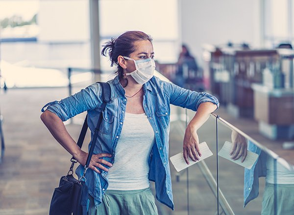 Photo of women at the airport, showing many are facing tough decisions to make about holiday travel as the U.S. Centers for Disease Control and Prevention strongly advises against holiday travel. (Photo credit: Getty Images)