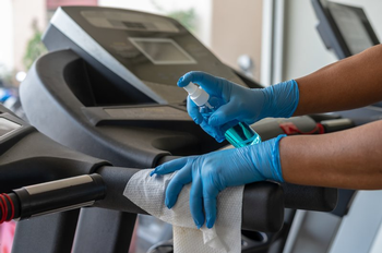 Gym equipment should be sanitized after every use. (Photo credit: Getty Images)